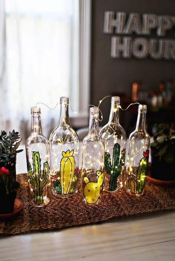 Adornos con botellas de vidrio recicladas y guirnaldas de luces