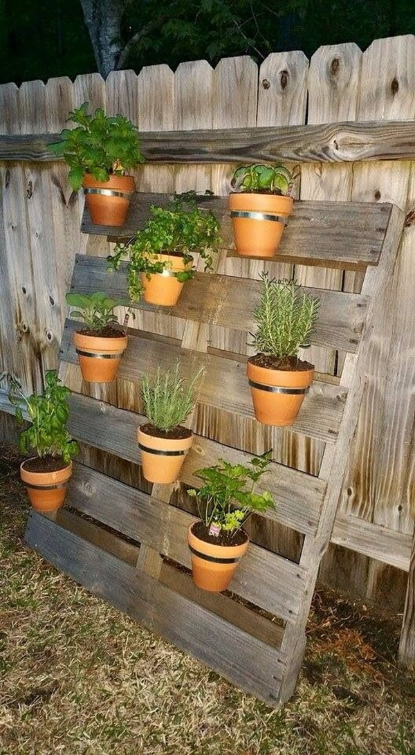 Maceteros hechos con palets de madera maceteros diy for Deco en palet de madera