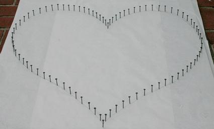 Corazón con hilo
